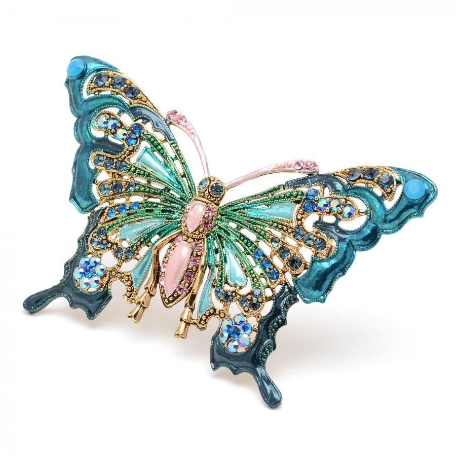 Broche dorado con forma de mariposa verde